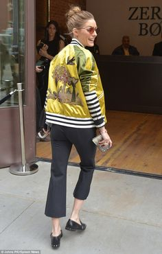 Olivia Palermo - On trend: The 31-year-old teamed cropped trousers with a striped top and colorful satin bomber jacket - May 23, 2017