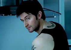Richard Armitage in Spooks, playing Lucas North who actually isn't Lucas North... *spoilers* (It amuses me that they probably had to draw all those tattoos on with a sharpie every time he had a topless scene!)