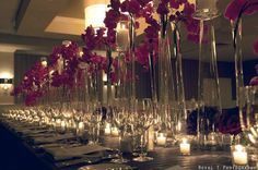 Family style table with tons of orchids and candles. by: Luxe Floral + Event Design