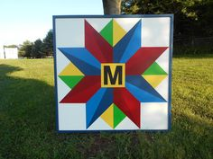 Rolling Star barn quilt with monogram and frame