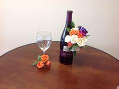 #artisticbloom #winebottlecenterpiece #jlohr #wineandroses