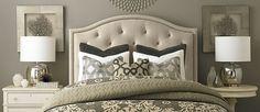 mismatched nightstands, upholstered headboard