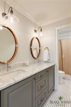 Lovely Bathroom Features A Gray Dual Washstand Topped With Carrera Marble Ed His And Her Sinkodern Faucets Placed Under Individual Oval Rope