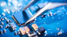 Working art print featuring the photograph electronic technician holding tweezers and assemblin a circuit board. Semiconductor Manufacturing, Electronic Technician, Cheap Gadgets, F Secure, Electronics Companies, Electronics Gadgets, Computer Chip, Apps, Tecnologia