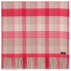 The Pinks collection is inspired by a young, feminine palette. Pink is the sweet side of red and is representative of sugar and spice and all things nice. In this collection it is teamed with our classic patterns allowing it to have a timeless feminine twist. The colours and patterns in this Foxford Throw have a very contemporary look and would be comforting in any home.