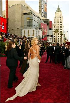 Charlize Theron on the red carpet. Oscars.  love the whole look-the wavy hair, bronzed skin with this color dress, makeup, etc