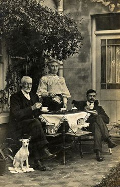 Edwardian tea on the tiles. This photograph taken by Edwards & Son, Worthing was sent as a New Year Card. The dog has its own mat.