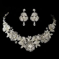Exquisitely beautiful floral necklace and earrings set that is made entirely of various floral designs made of silver plating and adorned with sparkling rhinestones accents all over the flowers and scatter Swarovski crystals. This beautiful set is both lovely and radiant, the perfect accessory for any formal event that is in need of a glamorous touch.
