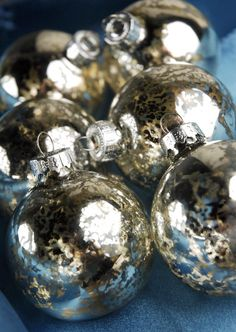 Christmas Ornaments Silver Mercury Glass Ornament Balls - Clear glass balls with alcohol sprayed in side and then silver looking glass spray paint.  Dry and recap.  Or buy them from Save on Crafts