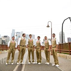 Irish linen pants and vests were combined with coral-colored ties and cream Converse All-Stars for the groom and groomsmen's funky, casual attire.