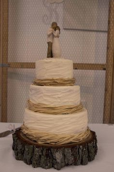 Rustic wedding cake with Willow tree topper! Couldn't have asked for a better wedding cake! I loved it!