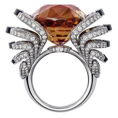 L'Odyssée de Cartier high jewellery ring in white gold, set with a 33.42ct brown tourmaline, obsidian and diamonds.