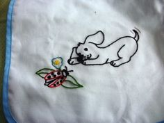 Puppy black Playing with Lady Bug Baby Bib by AndreasNeedlework