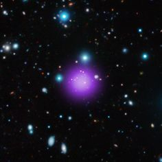 Galaxy cluster CL J1001+0220, located about 11.1 billion light years from Earth. Within about 250,000 light years of the center of the cluster (its core), eleven massive galaxies are found and nine of those display high rates of formation. Specifically, stars are forming in the cluster core at a rate equivalent to about 3,400 Suns per year. (Credit: X-ray: NASA/CXC/Université Paris/T.Wang et al; Infrared: ESO/UltraVISTA; Radio: ESO/NAOJ/NRAO/ALMA)