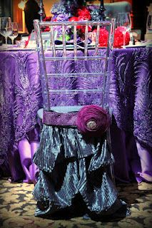 Not a huge fan of covering chiavari chairs but this is a gorgeous purple and peacock chair skirt