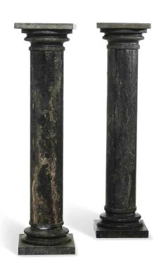 A PAIR OF BLACK MARBLE PEDESTAL COLUMNS