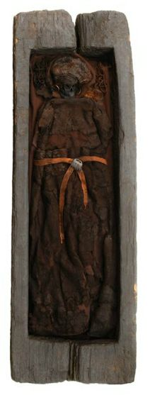 The woman from Skrydstrup. A preserved oak-log coffin from the Bronze Age (about 1300 BC) was found in a burial mound on Jutland in 1935.