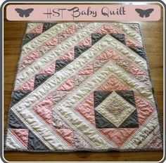 Baby girl quilt.  Pink & grey.  I absolutely love that this design is not centered!