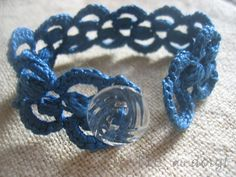 A crocheted bracelet with lace crochet. Elegant and colorfull.
