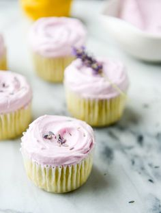 Lemon Cupcakes with Lavender Frosting by @howsweeteats. How gorgeous are these?
