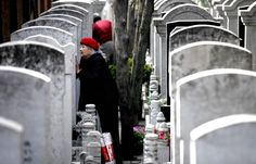 A woman visits the grave of her relative at Babaoshan Cemetery in Beijing, March 29, 2012. About 400,000 people will come to the cemetery to tend to the graves of their loved ones around the Qingming Festival, or Tomb Sweeping Day, which falls on April 4 this year. [Photo/Asianewsphoto]