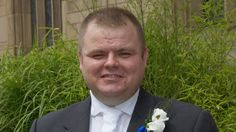 Two men are charged with the murder of off-duty Merseyside police constable Neil Doyle.