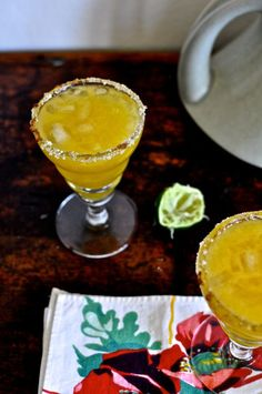 This spicy mango margarita is as easy as pie (or drinking a margarita). It's made with mango nectar, lime juice, tequila, and a sugar-chile rim!