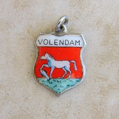 Volendam Netherlands Enamel Travel Shield Vintage Sterling Silver Bracelet Charm by Charmcrazey on Etsy