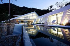 Tucked away in a scenic mountainside and offering jaw-dropping views over the neighboring island of Koh Phangan, Aqualina Holiday Villa is an amazing Houses Architecture, Amazing Architecture, Modern Architecture, Koh Samui, Samui Thailand, Glass Building, Architectural Features, Pool Houses, Glass Houses