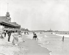 "Narragansett Pier: Rhode Island circa 1910. ""Narragansett Pier bathing beach."" Note the photographer and signage to the left: ""Want a Picture Taken in Your BATHING SUIT? 4 for 50 cents -- All Work Done by the LIGHTNING PROCESS."" 8x10 inch dry plate glass negative, Detroit Publishing Company. Click to view full size."