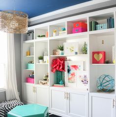 A Kailo Chic Life: Style It - Using Large Art Pieces in The Built-Ins - IKEA hack besta built-ins bookshelves minted art
