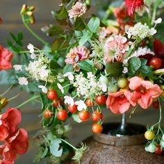 bouquet with cherry tomatoes - idea mainly to show how fruit can be woven loosely into a bouquet, but so cool in and of itself, too!
