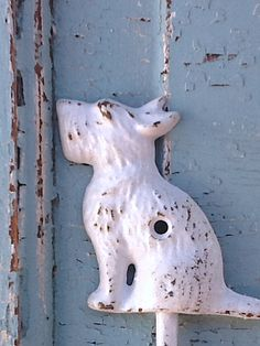 Modern Dog / Scottie Dog Wall Hook / Cast Iron / Shabby White / Wall Hanger / Metal Wall Decor / Patio / Shabby Home Decor. $8.00, via Etsy.