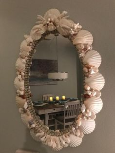 This is an example of one of my oval custom sea shell mirrors. Wood framed mirrors meticulously covered including edges when visible. Sea shells, starfish, sand dollars, pearls and coral. Optional centerpiece top crown with branch or lace coral and larger shells. Custom mirrors can be made any size