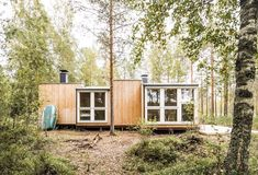 Dubbed Small but Fine, the 280-square-foot cabin connects with the outdoors and features a minimal footprint. Not pictured is a detached outhouse with a composting toilet. #dwell #finland #scandinaviandesign #moderncabin