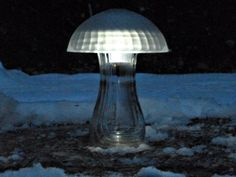 Mushroom Solar Lights to bring light to the darkness - this is recycling and salvage at it's finest; a couple of pieces of crystal or glass, and an old solar light, and Voila; something cool and funky for your garden.
