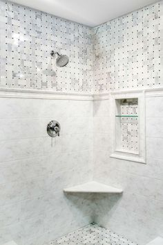Too busy on the top for my remodel, but love the classic bottom of the shower and the insert.