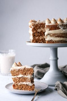 "This simple one bowl carrot cake is moist and delicious! Topped with a cashew ""cream cheese"" frosting, it's vegan friendly, refined sugar free, and includes a gluten-free option as well! Slow Cooker Desserts, Vegan Cake, Vegan Desserts, Vegan Recipes, Pavlova, Cake Recipes, Dessert Recipes, Dessert Food, Dairy Free Cream"