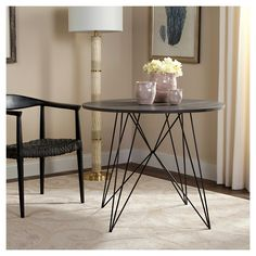 $260 This contemporary dining table was inspired by the industrial chic interiors of a top Danish restaurant. Its sleek, angular iron base creates depth and drama, while its round dark grey top ensures maximal seating options. A new design classic.
