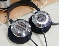 View images and photos in CNET's A bonanza of ultimate headphones and headphone gear (pictures) - The latest version of the Grado PS1000 headphones have mirror-finished earcups. These beauties are made in my hometown, Brooklyn, N.Y.!