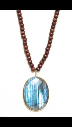 Check out out wood bead necklace with Labradorite Such a stunning piece!