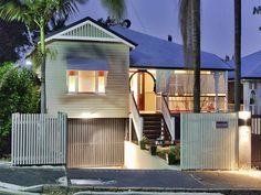 Photo of a corrugated iron queenslander house exterior with sash windows & path lighting - House Facade photo 211937. Browse hundreds of images of queenslander house exteriors & photos of corrugated iron in facade designs.