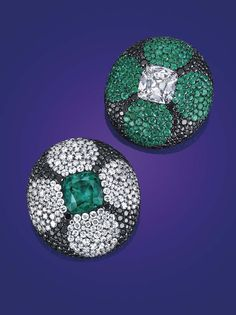 A pair of emerald, diamond and colored diamond ear clips by JAR .