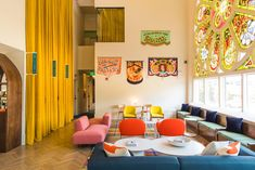 This Church-Turned-Hotel's Colorful Palette Is Just Heavenly #SOdomino #room #interiordesign #wall #furniture #property #yellow #table #building #livingroom #orange