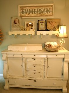 Vintage Blue Nursery Decor Brigitte  I like the changing pad on the dresser instead of a separate changing table.