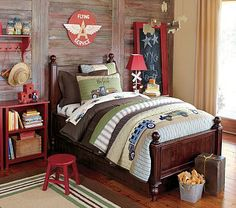 pottery barn kids - love the vintage trucks and the punches of red around the room even though the bedding does not have red
