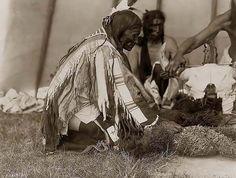 Sioux Indians kneeling at a bison skull altar