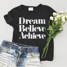 """Sincerely Jules dream believe achieve tee Sincerely Jules tee dupe! Original is sold out in stores. Size says """"large"""" but I think it would fit someone who is a size S-M best. Last photo shows me wearing the actual tee you will be getting. Dream Believe Achieve ❤️ willing to lower price by 10% to get you discounted shipping! Sincerely Jules Tops Tees - Short Sleeve"""