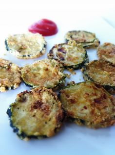 Skinny Breaded Zucchini Chips     1 Medium – Large Zucchini     1 Tbsp Olive oil     2 Tbsp Egg Whites     ¼ Cup – 1/3 Cup Almond Flour (depending on the size of your zucchini)     Salt and Pepper     (Condiments: Low-Sugar Natural Ketchup and Non-fat Plain Greek Yogurt – in place of sour cream)