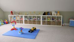 Along the long wall of the boy's room. Perfect with the pitch of the ceiling!